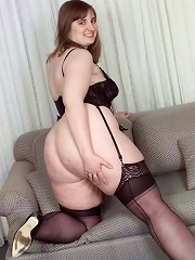 Blonde Plumper on a Sofa Spreading Trimmed Pussy