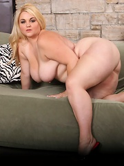 Chubby tart plows herself with a huge black sex toy