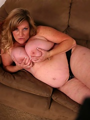 This pretty blonde BBW named Deedra strips off her clothes for the camera to unleash her huge rack